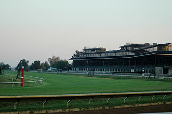 A view of Keeneland's grandstand at dawn, take...